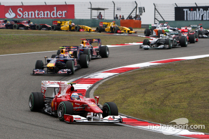 Fernando Alonso, Scuderia Ferrari leads Mark Webber, Red Bull Racing at the start of the race