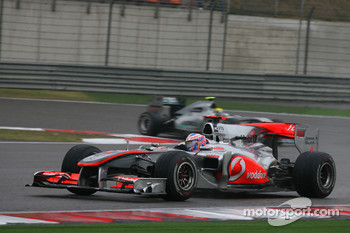Jenson Button, McLaren Mercedes leads Nico Rosberg, Mercedes GP