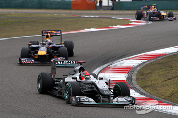 Michael Schumacher, Mercedes GP leads Sebastian Vettel, Red Bull Racing