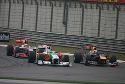 Adrian Sutil, Force India F1 Team and Sebastian Vettel, Red Bull Racing