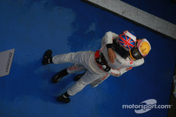 Race winner Jenson Button, McLaren Mercedes, celebrates with second place Lewis Hamilton, McLaren Mercedes