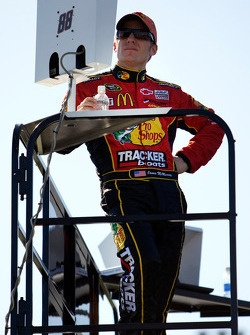 Jamie McMurray watches Nationwide practice on top of the JR Motorsports hauler