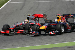 Sebastian Vettel, Red Bull Racing and Lewis Hamilton, McLaren Mercedes goes out of the pits