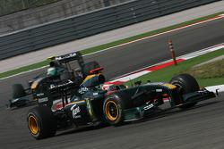 Jarno Trulli, Lotus F1 Team leads Heikki Kovalainen, Lotus F1 Team