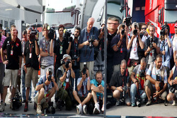 Photographers wait for the Mclaren team celebration photograph