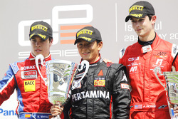 Rio Haryanto celebrates victory on the podium with Miki Monras and Alexander Rossi