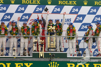 LMP1 podium: class and overall winners Mike Rockenfeller, Romain Dumas and Timo Bernhard celebrate with Dr. Wolfgang Ullrich, second place André Lotterer, Marcel Fässler and Benoit Tréluyer, third place Tom Kristensen, Rinaldo Capello and Allan McNish