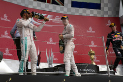 Race winner Lewis Hamilton, Mercedes AMG F1 celebrates on the podium with team mate Nico Rosberg, Mercedes AMG F1
