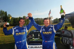 Craig Drew and driver David Higgins celebrate the Rally America championship