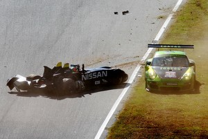 Crash between #0 Nissan DeltaWing Project 56 Nissan: Lucas Ordonez, Gunnar Jeannette and #34 Green Hornet Racing Porsche 911 GT3 Cup: Peter LeSaffre, Damien Faulkner, Brian Wong