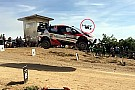 Automotive Slow-mo video of rally car jumping into a drone