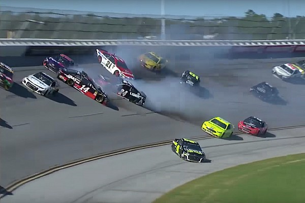 Johnson and teammate Byron collide, igniting 14-car wreck - video