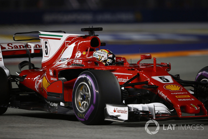 Pole man Sebastian Vettel, Ferrari SF70H, celebrates on his way to Parc Ferme