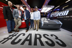 Disneys Brian Fee and Kevin Reher, Actors Woody Harrelson and Owen Wilson in the Cars 3 promotional garage