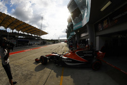 Fernando Alonso, McLaren MCL32, exits his pit garage
