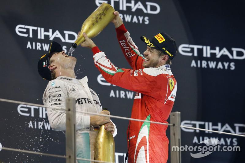 Podio: segundo lugar de Nico Rosberg, Mercedes AMG F1, tercer lugar Sebastian Vettel, Ferrari