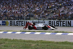 Alain Prost pushes his McLaren MP4-2C TAG after running out of fuel on the last lap