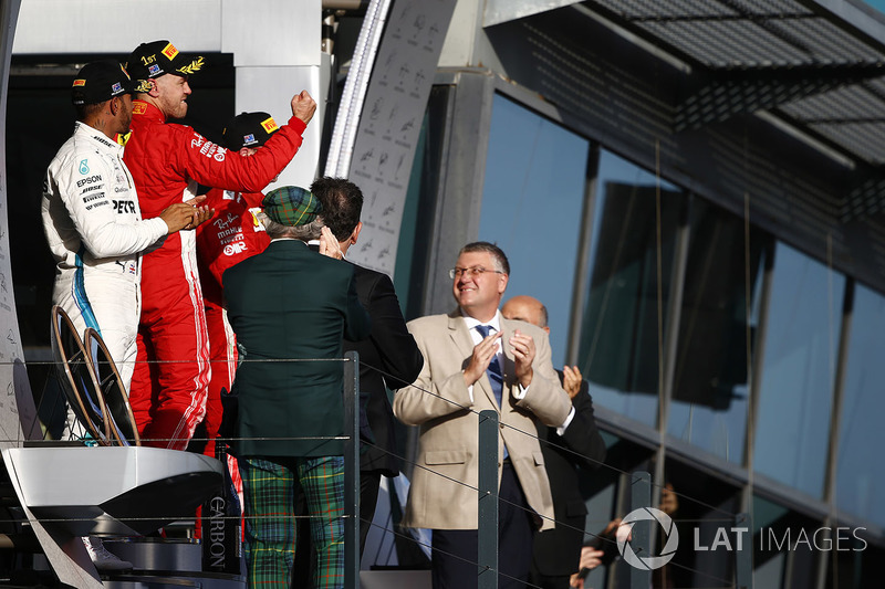 Lewis Hamilton, Mercedes AMG F1, 2nd position, Sebastian Vettel, Ferrari, 1st position, and Kimi Raikkonen, Ferrari, 3rd position, celebrate on the podium
