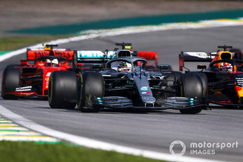 Lewis Hamilton, Mercedes AMG F1 W10 leads Max Verstappen, Red Bull Racing RB15 and Sebastian Vettel, Ferrari SF90 at the restart