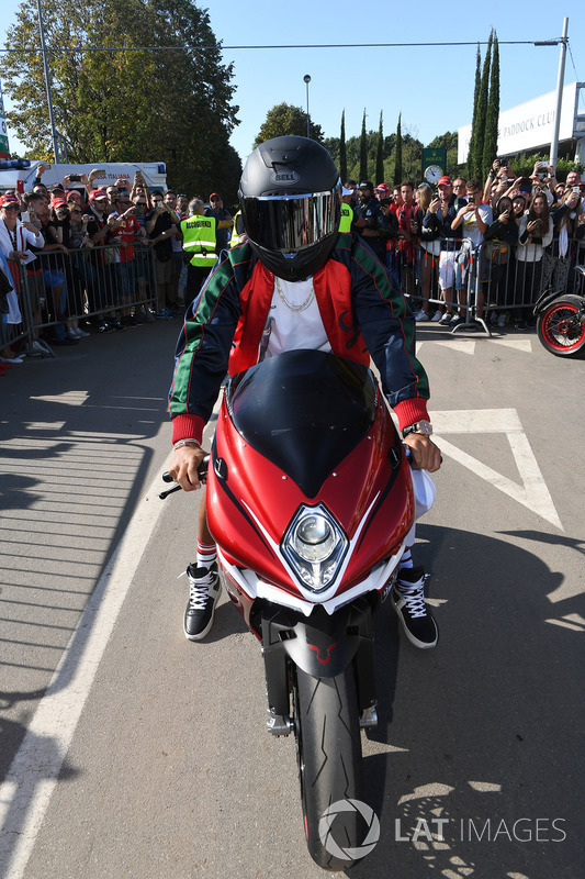 Lewis Hamilton, Mercedes AMG F1 arrives at the track on his motorbike