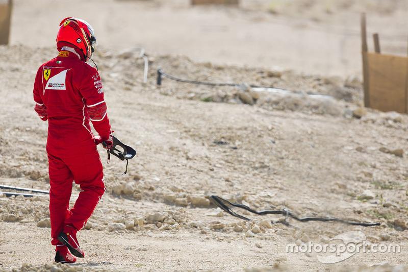 Kimi Raikkonen, Ferrari, walks back to his garage