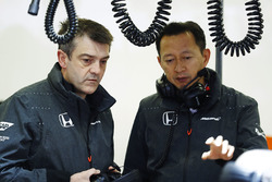 Yusuke Hasegawa, Honda Senior Managing Officer talks to a colleague