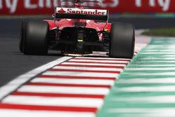 Sebastian Vettel, Ferrari SF70H, strikes up sparks