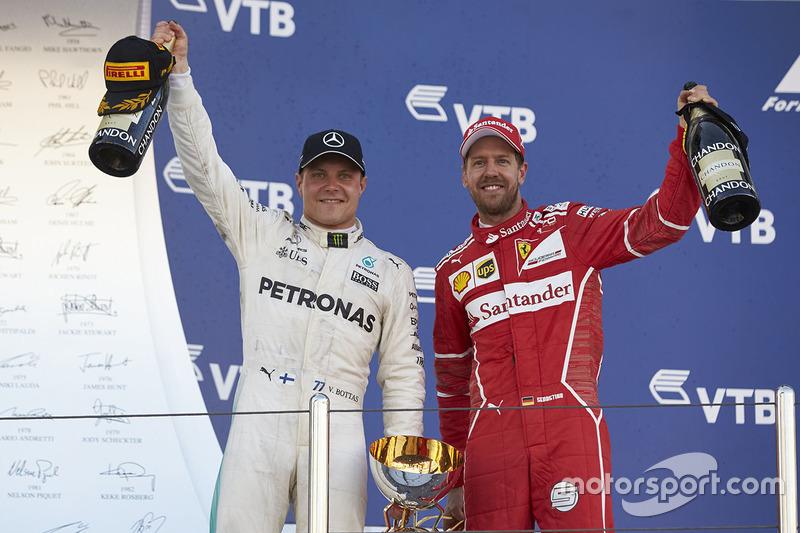 Race winner Second place Valtteri Bottas, Mercedes AMG F1 Sebastian Vettel, Ferrari