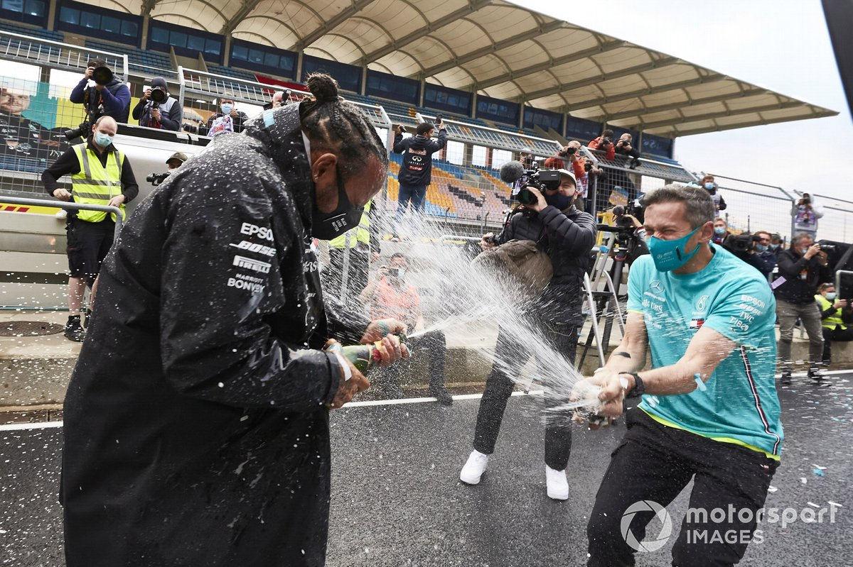 Lewis Hamilton, Mercedes-AMG F1, is sprayed with champagne by team in celebration of his 7th World Championshi title