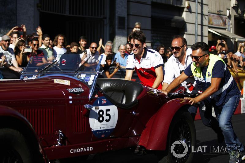 Charles Leclerc, Alfa Romeo Sauber F1 Team helps push a vintage car