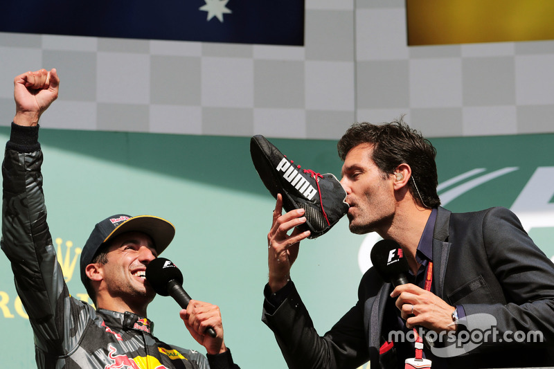 (L to R): Daniel Ricciardo, Red Bull Racing celebrates his second position on the podium with Mark W