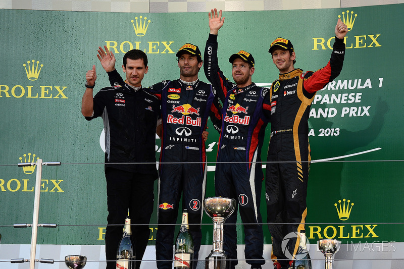 Remi Taffin, Head of Renault Sport F1 Track Operations, Mark Webber, Red Bull Racing, race winner Sebastian Vettel, Red Bull Racing and Romain Grosjean, Lotus F1 celebrate on the podium