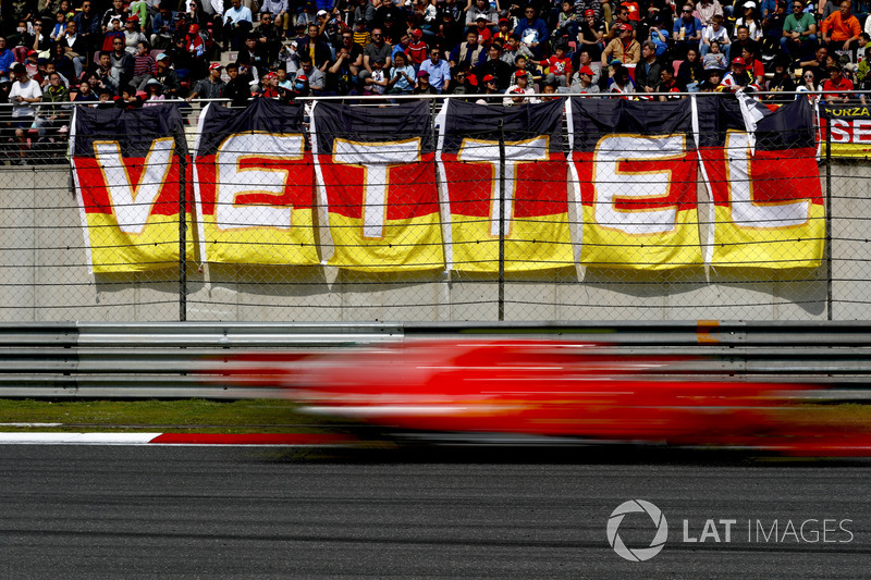 Sebastian Vettel, Ferrari SF71H, flashes past fans in a grandstand