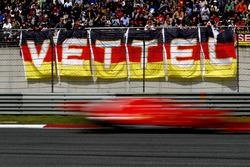 Sebastian Vettel, Ferrari SF71H, flashes past fans in a grandstand