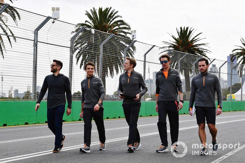 Lando Norris, McLaren, walks the track with his team