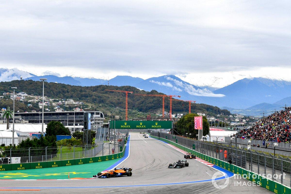 Daniel Ricciardo, McLaren MCL35M, Lewis Hamilton, Mercedes W12, and Sergio Perez, Red Bull Racing RB16B