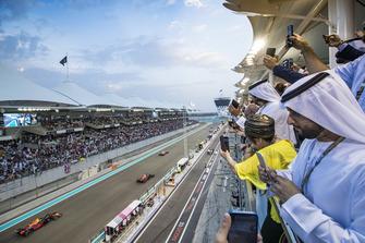 Kimi Raikkonen, Ferrari SF71H, leads Daniel Ricciardo, Red Bull Racing RB14, and Max Verstappen, Red Bull Racing RB14, away for the formation lap