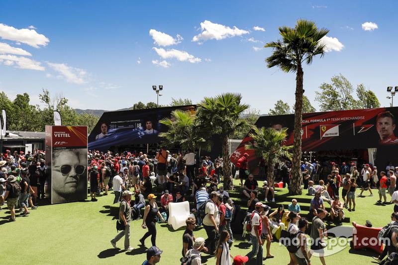 Fans enjoy the atmosphere in the fan village