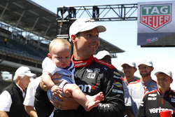 Will Power, Team Penske Chevrolet, celebrates winning the Pit Stop Competition with son Beau