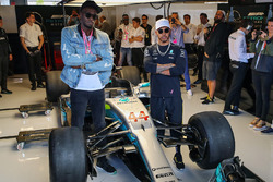 Usain Bolt, Lewis Hamilton, Mercedes AMG F1in the Mercedes AMG F1 garage