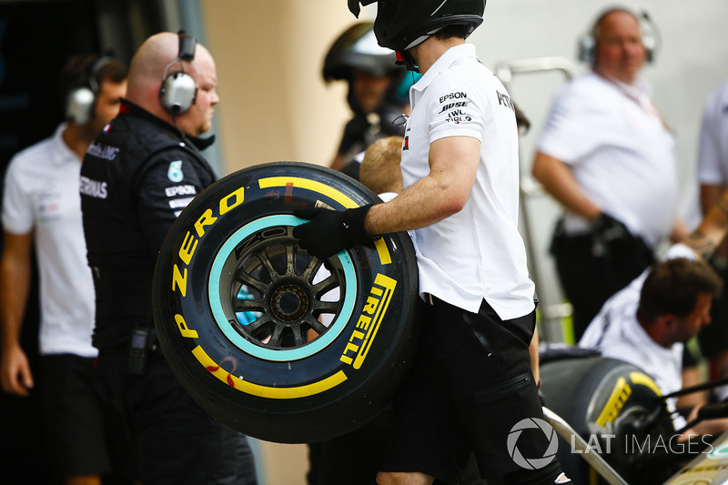 A Mercedes engineer with a Pirelli Soft tyre