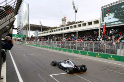 Lewis Hamilton, Mercedes AMG F1 W09, takes the chequered flag to win the race