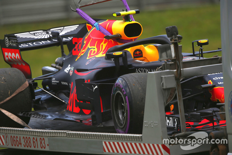 The Max Verstappen Red Bull Racing RB14 is returned to the pits on the back of a truck