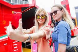 VIP guests take a selfie outside the Ferrari motorhome