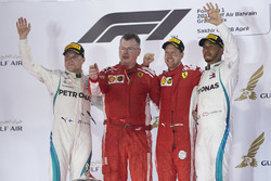 Valtteri Bottas, Mercedes AMG F1, 2nd position, The Ferrari Constructors Trophy delegate, Sebastian Vettel, Ferrari, 1st position, and Lewis Hamilton, Mercedes AMG F1, 3rd position, on the podium