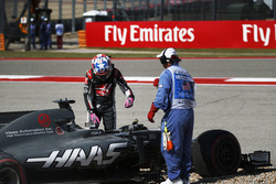 Romain Grosjean, Haas VF-17, climbs from his car after spinning