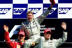Podium: second place Michael Schumacher, Ferrari, Race winner Mika Hakkinen, McLaren, third place David Coulthard, McLaren