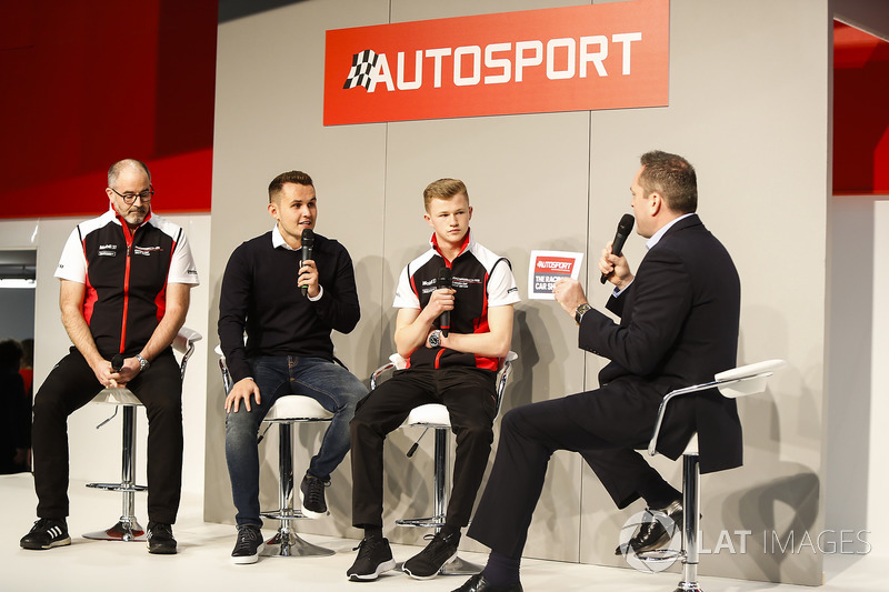 James MacNaughton, Dan Harper and Charlie Eastwood from Porsche talk to Henry Hope-Frost on the Autosport Stage