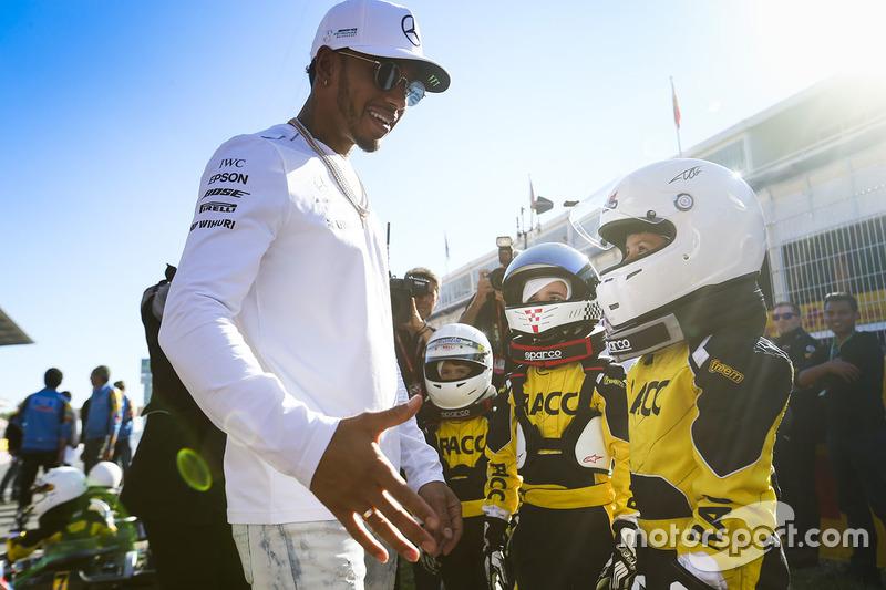 Lewis Hamilton, Mercedes AMG F1, meets some junior RACC Karter