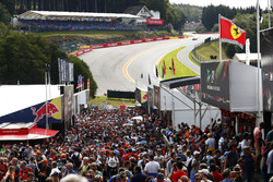 Fans between merchandising stands at the bottom of Eau Rouge